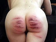 Pretty blonde girl in tears from brutal caning - severe welts and stripes