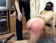 Tears of pain for pretty girl stripped naked and spanked over a chair - burning red buttocks