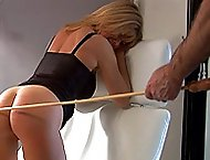 Stunning blonde beauty spanked and caned on her ripe young bottom