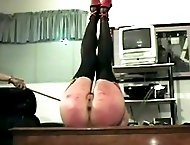 Brutal paddling on her bruised and battered buttocks in the office