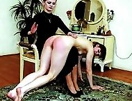 Tied to a table with her knickers ripped down - purple cane stripes on soft white buttocks