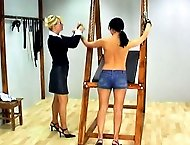 Valerie has been caught by the headmistress wearing daisy dukes and is escorted to her office for punishment