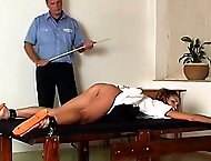German girl strapped to a table and thoroughly caned