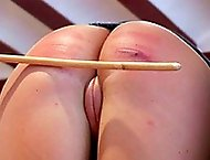 Innocent looking sweetie bends over the chair for a caning exposing her wet hairless cunt