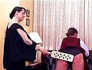 School girl in uniform bares her pretty bottom for blistering spanking and caning - red swollen chee