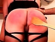 Big assed blonde bends over displaying her ass and cunt - severe bare bottom paddling