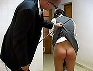 Two pretty school girls in uniform severely caned back to back