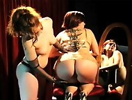Lazella does a wicked strip before turning her bare bottom over to Mistress Amber for punishment